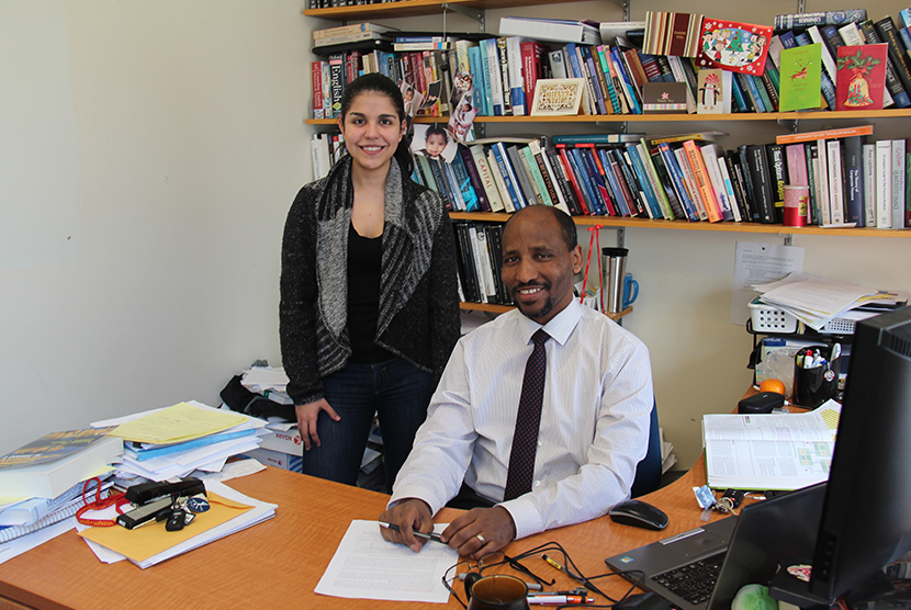 Student and professor sitting at desk