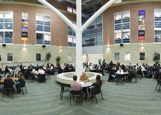 Science atrium students around tables